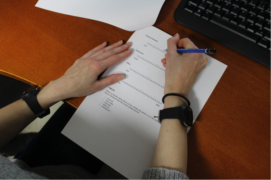 The research participant is filling out a questionnaire. Image: Camilla Groth.