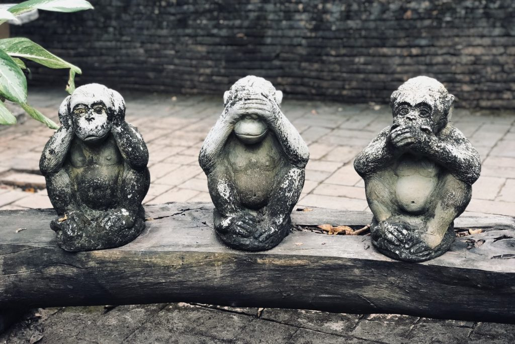 Statues of the three wise monkeys.