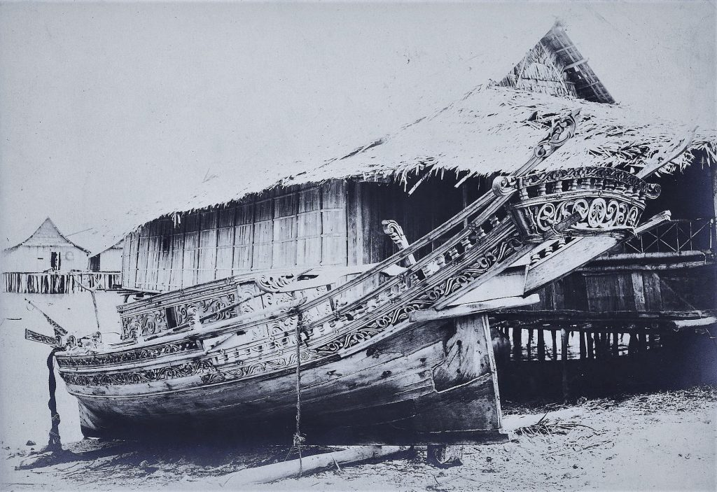Black-and-white photograph of a boat on a shore
