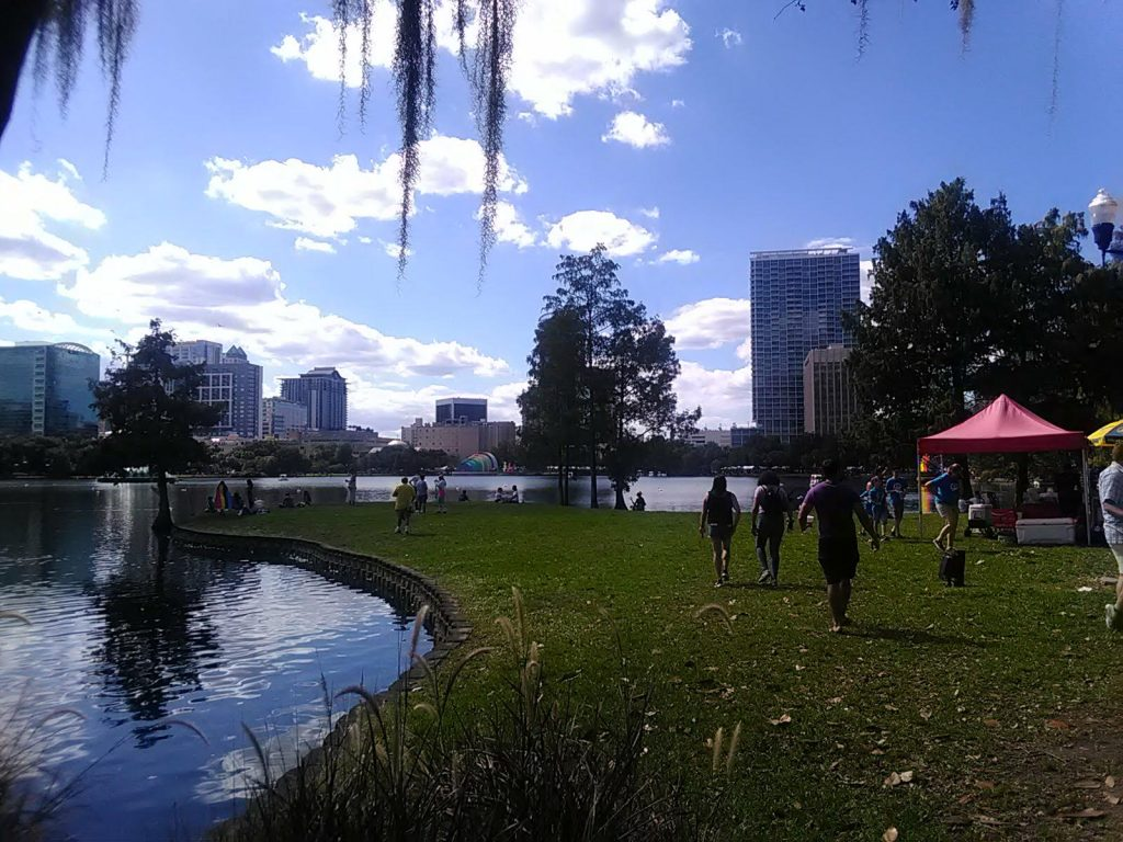 People enjoying the day in central Orlando during Pride celebrations.