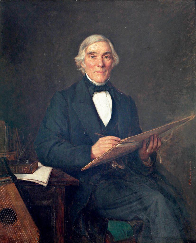 Elias Lönnrot håller ett skrivunderlägg i famnen och skriver.
