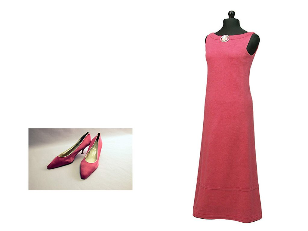 A red, sleeveless evening dress with red pumps.