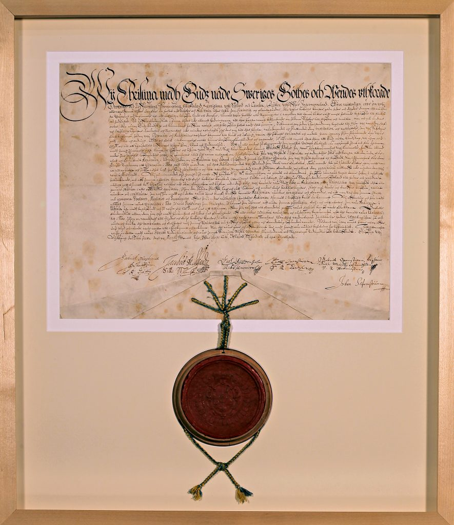 A document with a large, round wax seal