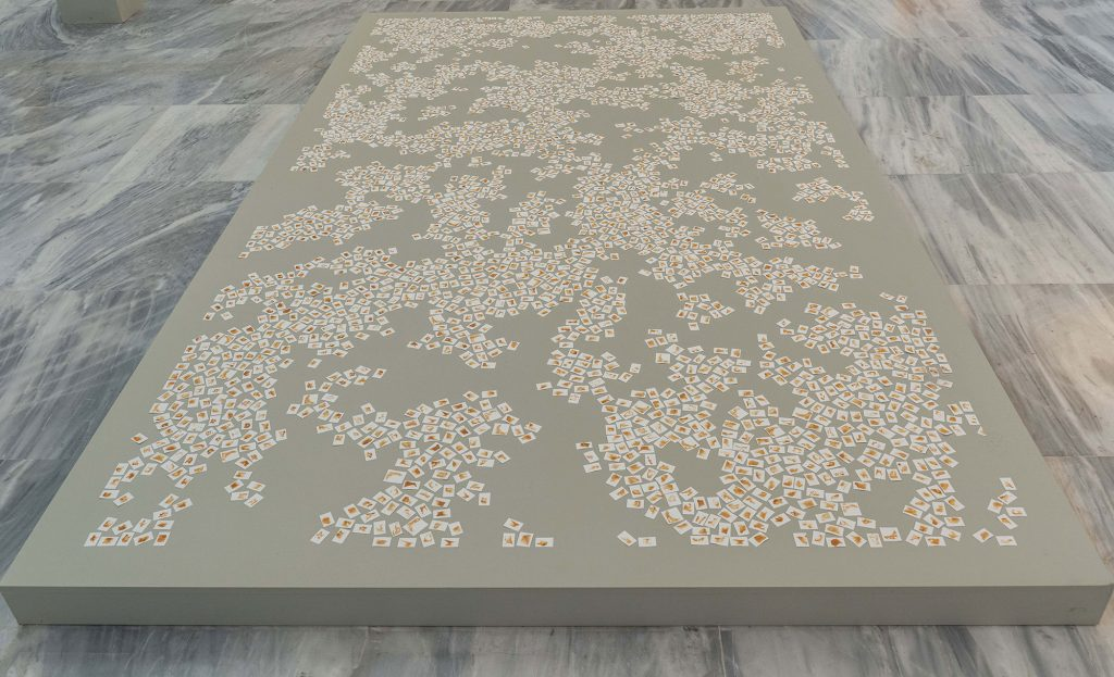 An artwork of a mosaic on a grey platform