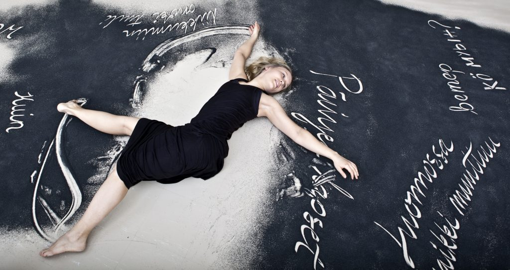 The multimedia piece Maa by art collective Liiketila combines dance with word art, visual expression and design. The piece is based on language resources digitised in the Digitisation Project for Minority Languages. (Photo: Heidi Kotilainen)