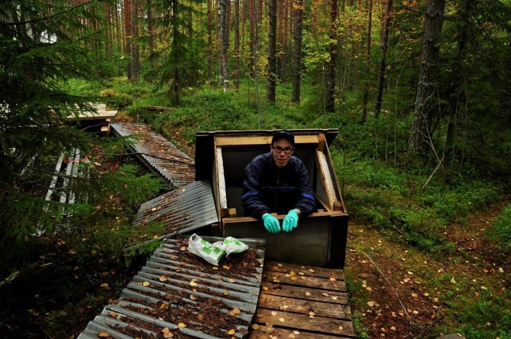 The writer is taking some water samples from a dam. This was done only when the dams were leaking. Picture: Sini Salko.
