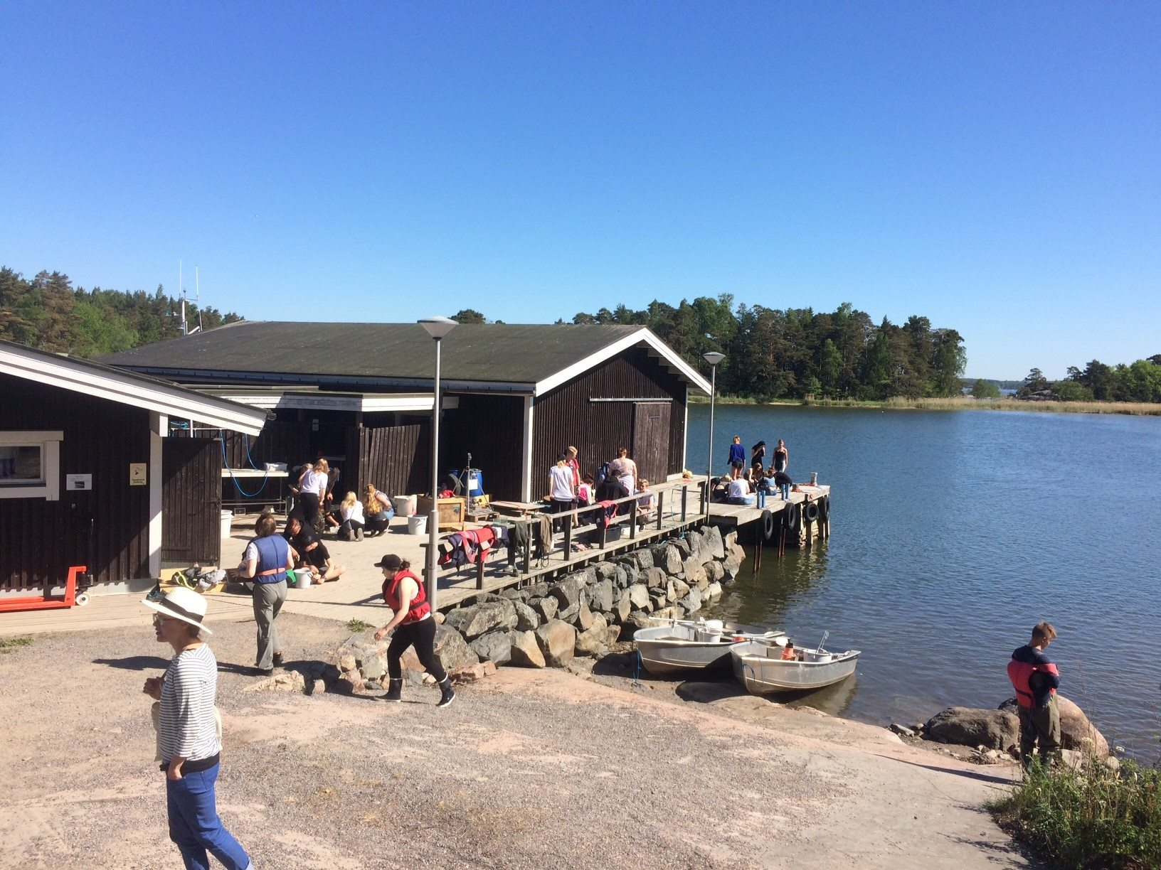 TZS boat house and pier full of people.