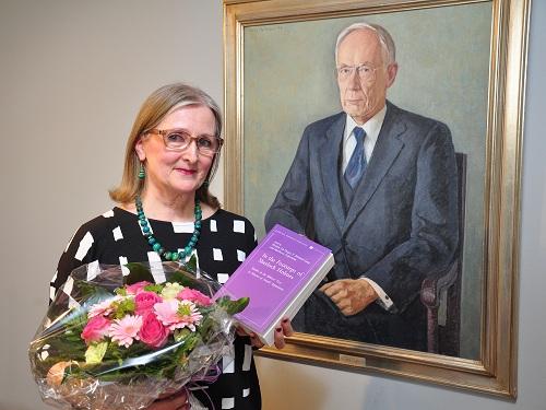 Anneli in front of the portrait of her teacher Prof. Ilmari Soisalon-Soininen.