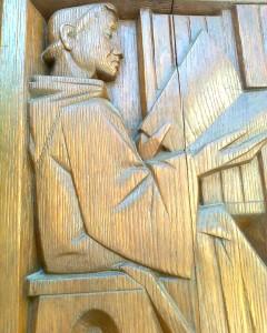 Lukeva munkki. S. Gallenin kirjaston ulko-ovi.